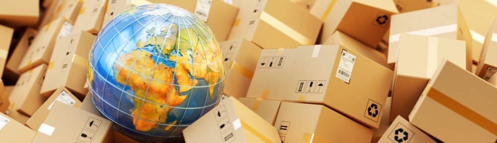 a globe sitting on top of a pile of packages