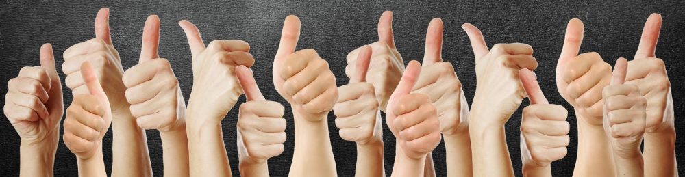 a bunch of hands giving the thumbs up