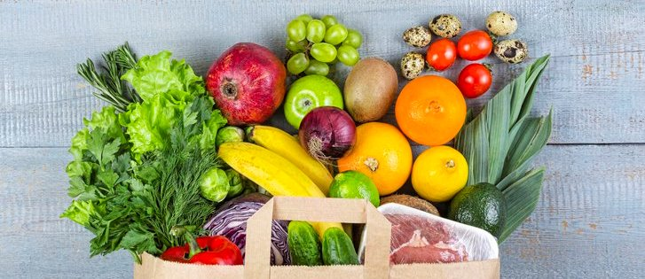 A paper grocery bag of fresh produce